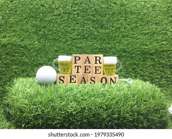 Goof ball with glass of beer for par tee season are on green grass - Shutterstock ID 1979335490
