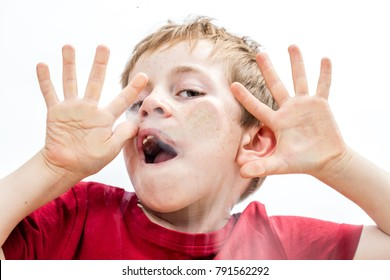goofy little boy playing silly, touching his face and hands for crushed silly misbehavior or frightening childhood, white background