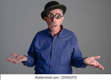 Goofy man with thick glasses looking at the camera