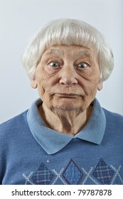 Goofy senior woman head and shoulders portrait