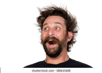 Goofy young man, with full beard and moustache and wild hair style, screams with joy. Studio portrait over white. Space for your text.