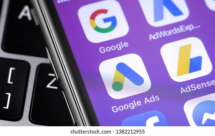 Google Ads AdWords app icon on smartphone screen and laptop. Moscow, Russia - April 27, 2019