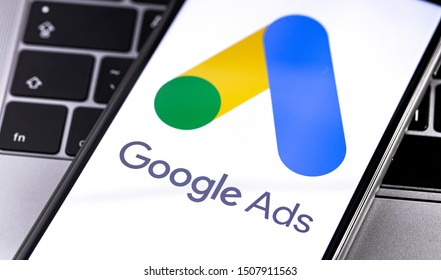 Google Ads logo on the screen smartphone with notebook closeup on keyboard background. Google is the biggest Internet search engine in the world. Moscow, Russia - August 23, 2019