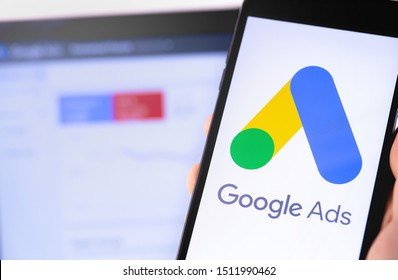 Google Ads logo on the screen smartphone and notebook background. Ads is a service of contextual, basically, search advertising from Google. Moscow, Russia - August 24, 2019