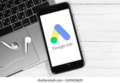Google Ads start page the screen iPhone, Macbook closeup. Ads is a service of contextual, basically, search advertising from Google. Moscow, Russia - December 20, 2019