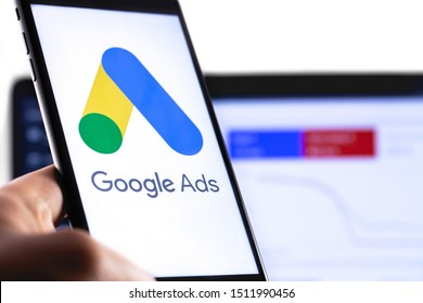 Google Ads symbol on the screen smartphone and notebook background. Ads is a service of contextual, basically, search advertising from Google. Moscow, Russia - August 25, 2019