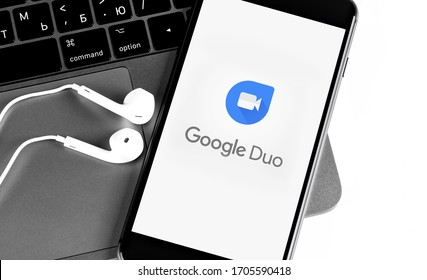 Google Duo mobile application on the screen smartphone with Earpods and notebook closeup. Google Duo is a video chat developed by Google. Moscow, Russia - November 27, 2019