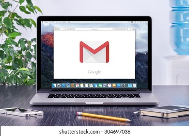 Google Gmail logo on the Apple MacBook Pro display that is on office desk workplace. Gmail is a free e-mail service provided by Google. Varna, Bulgaria - May 31, 2015.