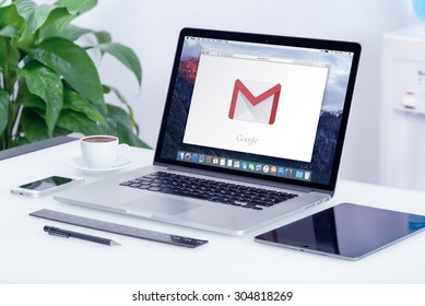 Google Gmail logo on the Apple MacBook Pro display that is on office desk in modern office work place. Gmail is a free e-mail service provided by Google. Varna, Bulgaria - May 29, 2015.