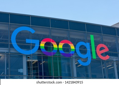 Google logo displayed on company headquarters in Silicon Valley. The double o's are decorated in rainbow colors in honor of LGBTQ Pride Month - Mountain View, California, USA - June 11, 2019