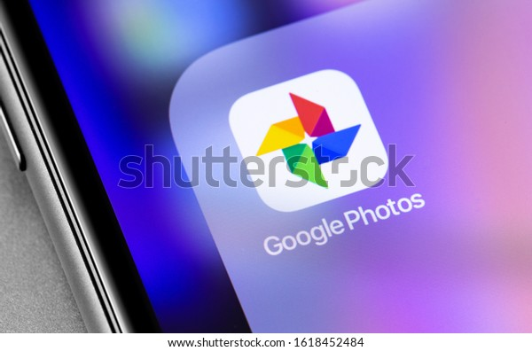 Google Photos icon application on the screen smartphone. Google Photos - a service designed to store, edit, share photos and videos. Moscow, Russia - November 25, 2019