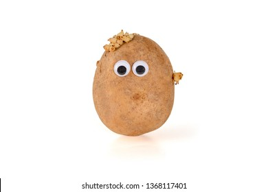 Googly eyes. Funny cute brown mister Fresh Potato isolated on white background.