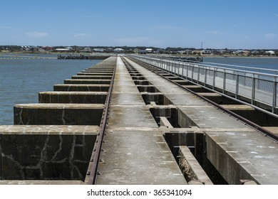 Goolwa Barrage Lock, South Australia. In landscape orientation looking out over the length of the lock from the Goolwa side toward Hindmarsh Island.