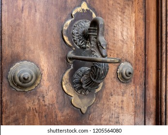 Goose door pull on a heavy wooden door