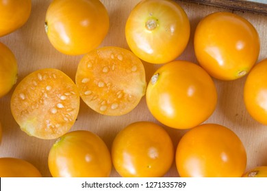 Gooseberries close up top view photo. Yellow Cape gooseberry background