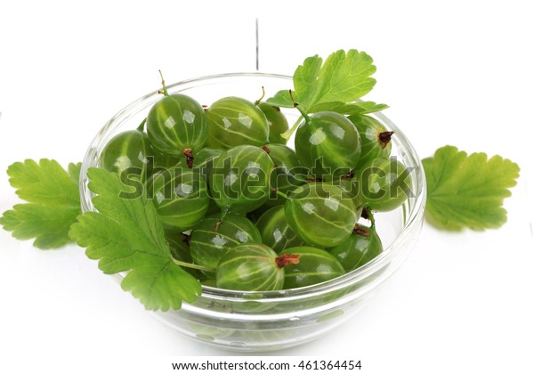 Gooseberry on a white wooden background
