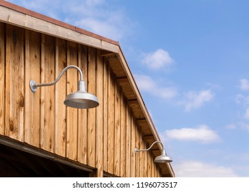 Gooseneck lights on wood barn wall