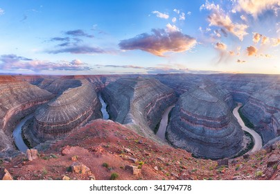 Goosenecks are a famous entrenched meanders on San Juan river. Sunset time. Goosenecks State Park, Utah - USA. Panoramic photo
