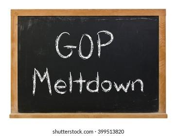 GOP meltdown written in white chalk on a black chalkboard isolated on white