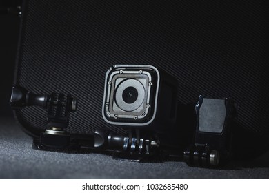 GoPro camera without labels. Close up look on action camera on grey background. Shard and detailed look with great depth of field.