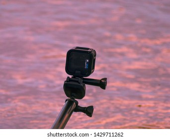 GoPro Hero 5 session on selfie stick shooting time-lapse video of beautiful sunset of noadihing river bank of Tinsukia District /Assam/India on 19th June 2019