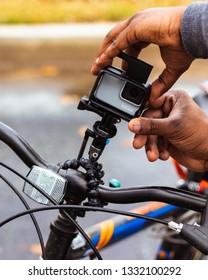 GoPro Hero 7 White action camera in housing on bike handle bars Baton Rouge, Louisiana USA - December 31 2018