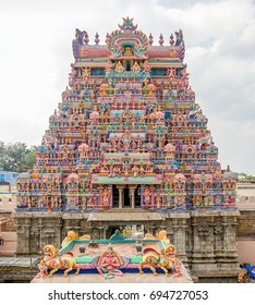 The Gopuram, a monumental entrance tower, decorated with ornate sculptures of Hindu gods and goddess of the Srirama Puram Temple in Srirangam, Tamil Nadu, India