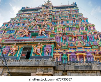 The Gopuram, which is a monumental tower, decorated with ornate sculptures of Hindu gods and goddess, at the entrance of the Chidambaram, Hindu temple, in Tamil Nadu state of Southern India.