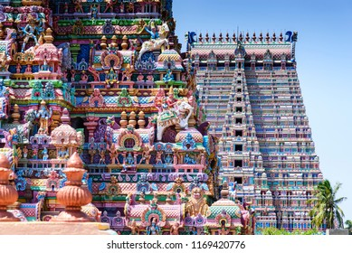 Gopurams in Sri Ranganathaswamy Temple, India. A Gopuram is a monumental gatehouse tower, usually ornate, at the entrance of a Hindu temple usually found in the southern India