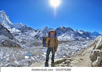 Gorak Shep, Nepal - January 07, 2015: Smiling Sherpa trekking guide poses for a photo , way to Everest base camp, Sagarmatha national park, Khumbu valley, Solukhumbu, Nepal Himalayas mountains