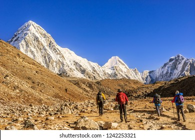 Gorak Shep, Nepal - November 1, 2018: People hiking on a trek route to Everest Base Camp. Picturesque view at Pumori, Lingtren and Khumbutse peaks view from the trekking route near Gorak Shep, Nepal
