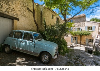 GORDES, FRANCE - JULY 1st 2017: Typical french car Renault 4 parked on the driveway on one of the small streets in the Gordes, Provence, France