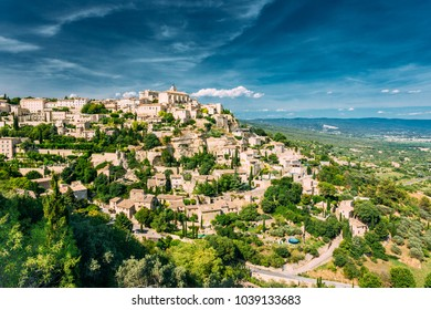 Gordes, Provence, France. Beautiful Scenic View Of Medieval Hilltop Village Of Gordes. Blue Sunny Summer Sky. Famous Landmark
