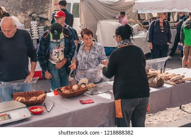 Gordes, Provence-Alpes-Cote d'Azur, France, September 25, 2018: Trade in fresh bread and pastries - the traditional farmers market in Provence
