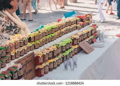 Gordes, Provence-Alpes-Cote d'Azur, France, September 25, 2018: Shop with sweets, confiture, jam - the traditional farmers market in Provence