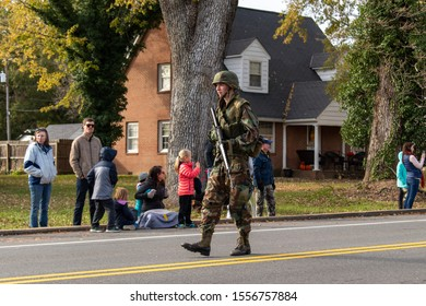 Gordonsville, VA/USA - November 9, 2019: The Gordonsville Veterans Day Parade. A loan army soldier marches down the parade route with a machine gun in hand.