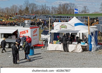 GORDONVILLE PENNSYLVANIA - March 11, 2017: Annual spring auction `Amish Mud Sale` to benefit the Fire Company. Sale items include quilts, antiques, crafts, food, tools, farm equipment, and horses.