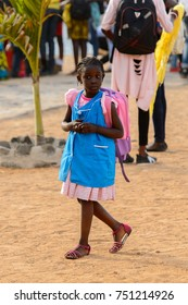 GOREE, SENEGAL - APR 28, 2017: Unidentified Senegalese little girl walks with backpack on the Goree Island, the former slave isle