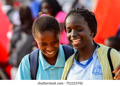 GOREE, SENEGAL - APR 28, 2017: Unidentified Senegalese girl with braids smiles on the Goree Island, the former slave isle