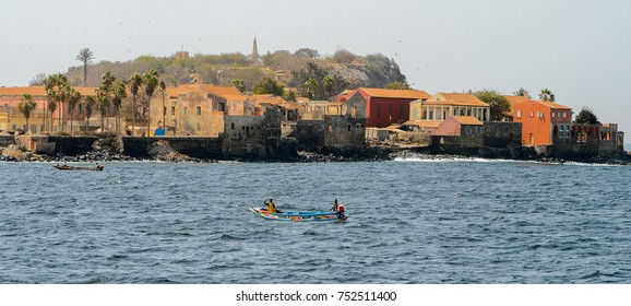 GOREE, SENEGAL - APR 28, 2017: Unidentified Senegalese men sail on boat in the Atlantic ocean near the Goree Island