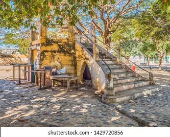 Goree, Senegal- February 2, 2019: Stairway leading to a ruined-concrete made-open air kiosk on the main square of Goree island. Gorée. Dakar, Senegal. Africa. Ille de Goree.