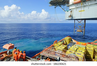 GOREK OILFIELD, MALAYSIA - APRIL 6, 2014: Search and rescue of a man overboard drill carried out between a Jack up platform and the offshore vessel in Gorek Oilfield, Malaysia in 2014.