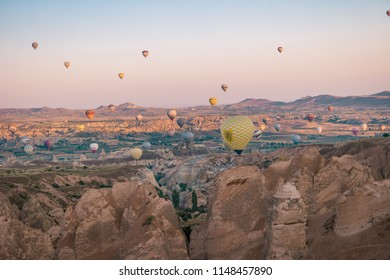 Goreme Capadocia kapadoya Turkey July 2018, Sunrise over the hills with hot air balloons in the sky , colorful landscape