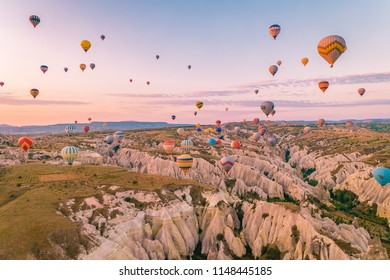 Goreme Cappadocia Turkey July 2018, hot air balloons during Sunrise over the fairytale landscape hills of Kapadokya