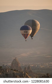 Goreme, Kapadokya / Turkey - 21 June 2017: Big and small hot air balloon flying together in the sky over Kapadokian valley