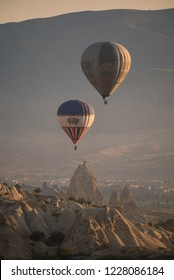 Goreme, Kapadokya / Turkey - 21 June 2017: Big and small hot air balloon flying together over beautiful rocks