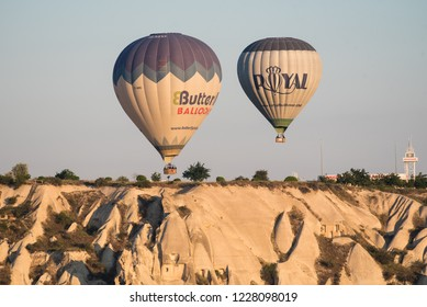Goreme, Kapadokya / Turkey - 21 June 2017: Closeup of two hot air balloons with tourists flying above valley