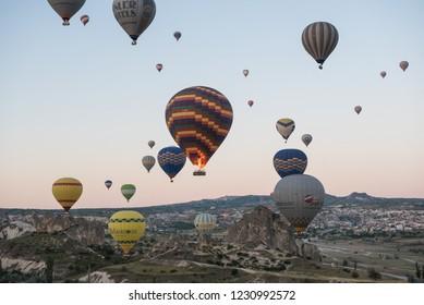 Goreme, Kapadokya / Turkey - 24 June 2017: Colorful balloons in the air on sunrise
