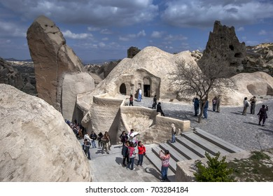 GOREME, TURKEY - APRIL 10, 2010 : Visitors to the Open Air Museum near Goreme in the Cappadocia region of Turkey file out of the Chapel of St Basil containing the fresco of Jesus Christ.