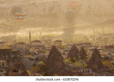 GOREME, TURKEY - APRIL 28: Hot air balloons flying over Cappadocia with beautiful background on April 28, 2017 in Goreme, Cappadocia, Turkey.